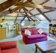 Open plan living space; exposed beams and original mill workings