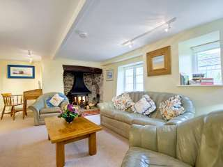 Cosy sitting room with inglenook fireplace