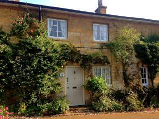 Grade II listed Cotswold golden stone cottage