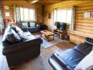 Spacious living area at Greenfinch Holiday Lodge