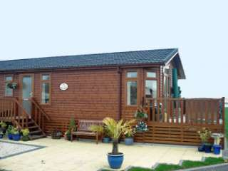 self-catering pine lodge with lovely interior