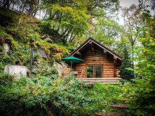 Secluded Log Cabin on the River Lyne