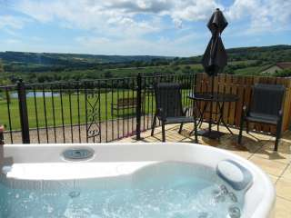 Relax in your own hot tub overlooking stunning views.