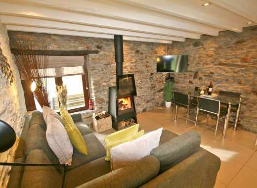 Living Room with Glass Fronted Log Burner & PS4
