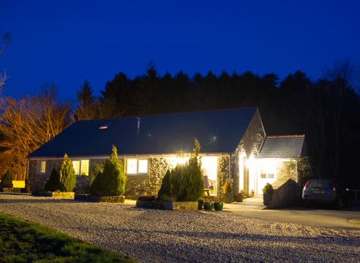 5* Gold Mole End cottage at night