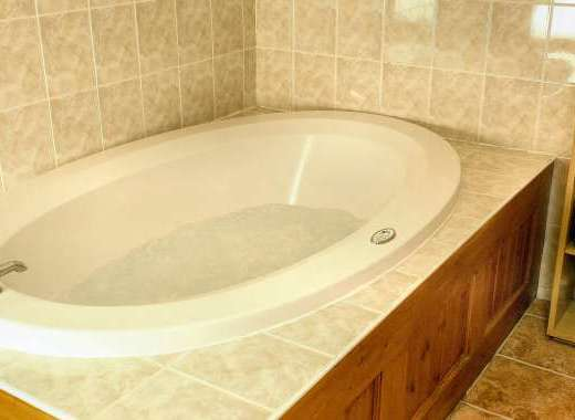 Spa bath in a romantic couple's holiday cottage at Dittiscombe