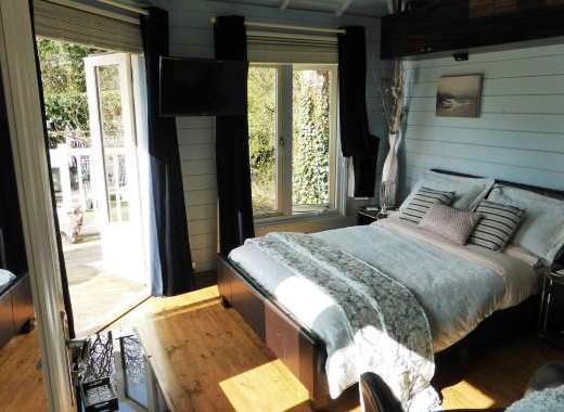 Beautifully furnished sunny bedroom with French doors onto your balcony with mountain views