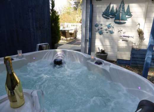 TRomantic heart shaped spa hot tub under permanent cover to enjoy whatever the weather