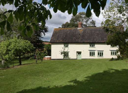 Four Hundred Year Old Somerset Farmhouse Set In Large Gardens