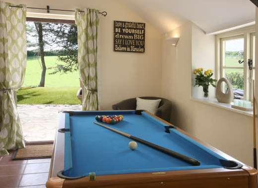 Games Room With A Pool Table Opening Up Onto The Huge Garden