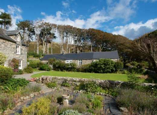 Dove Cottage looks out on Llanfendigaid's beautiful gardens and grounds