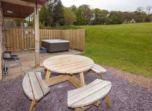 Outdoor seating at Beech Cottage