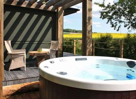 Each Romantic Lodge is complete with a private hot tub