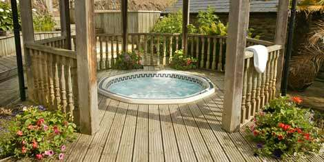 Relax in the warm outdoor hot tub