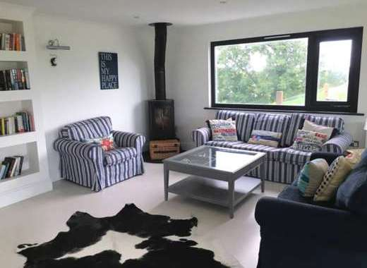 Lounge area with warming woodburner