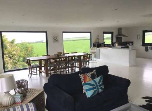 Open plan living area with superb countryside and coastal views