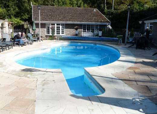 Heated outdoor pool just 30 yards from the cottage