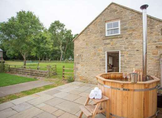 Hayloft barn conversion with hot tub