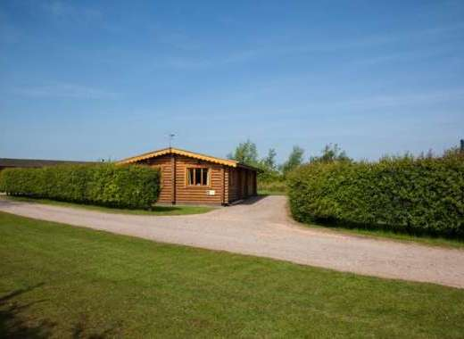 Bullfinch Lodge exterior two bedroom 4* log cabin