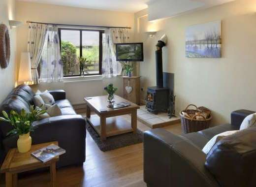 The sitting room in Cornflower Cottage