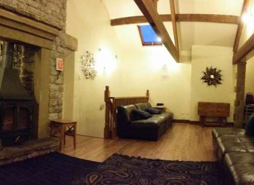 Living roomwith feature fireplace at Peak DIstrict holiday home for rent