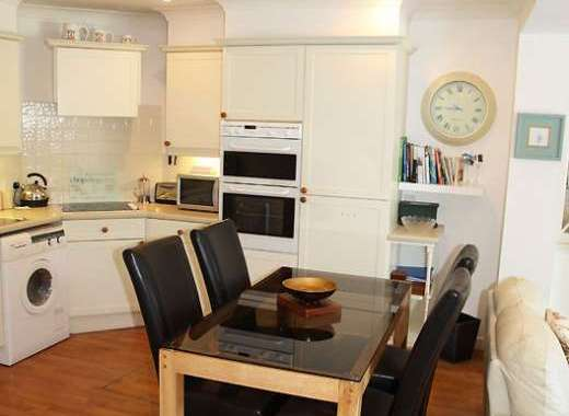 A holiday accommodation with a table in the kitchen