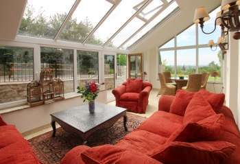 Magnificent conservatory overlooking gardens and terraces