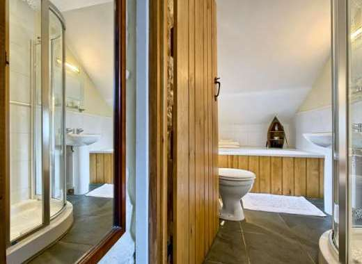En suite with bath and shower