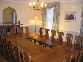 Dining tables can be rearranged. Seats 34