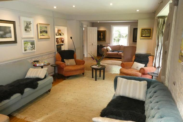 Large Sitting Room with wood burner and open fire