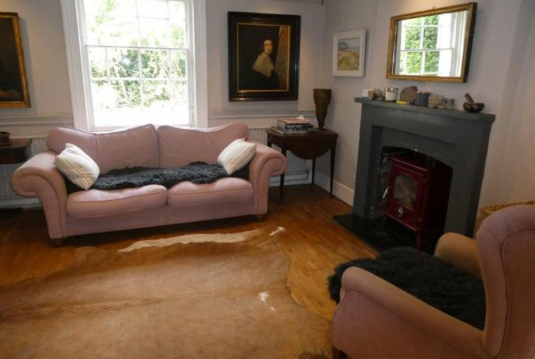 Cosy end of the Sitting Room with wood burner