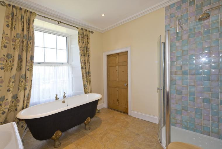 The ensuite bathroom with french bath