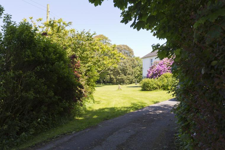 Located at the end of a private entrance drive the House cannot be easily seen from the lane