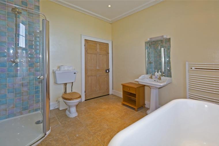 En suite to the master bathroom has dual access