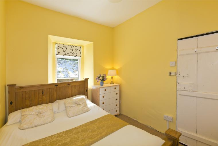 The ground floor bedroom overlooks a sunny courtyard