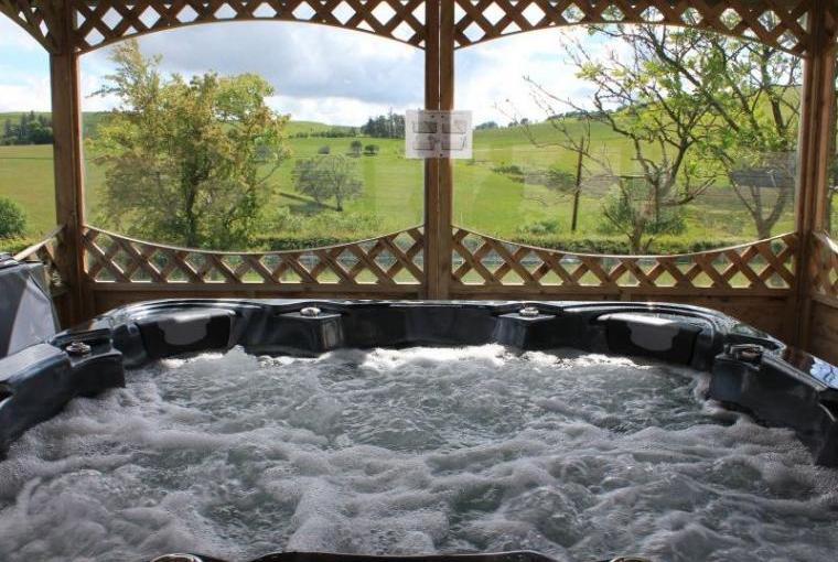 Hot tub within all weather gazebo