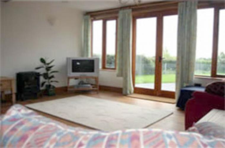 Light and spacious lounge with doors opening out in to the garden