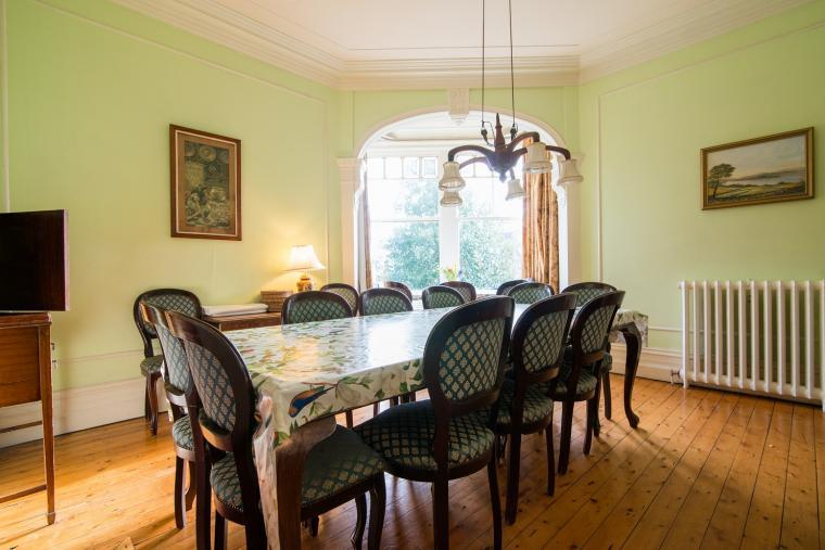 Many silver servce and buffets are enjoyed in the bright dining room