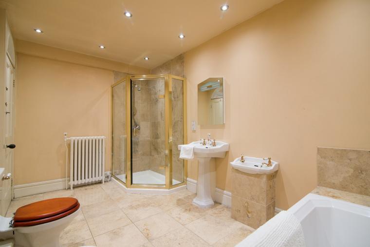 The family bathroom has a 6' bath and double shower