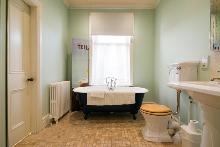 The Master Bedroom en suite has a double ended antique bath