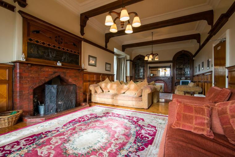 The huge sitting room has an open fire and southerly aspect