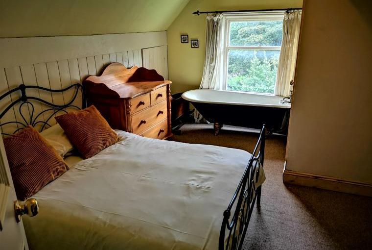 Ravensprings attic bedroom has a toilet en suite