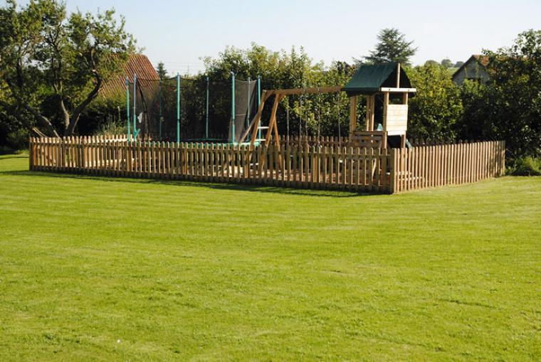 Play area with trampoline and slides
