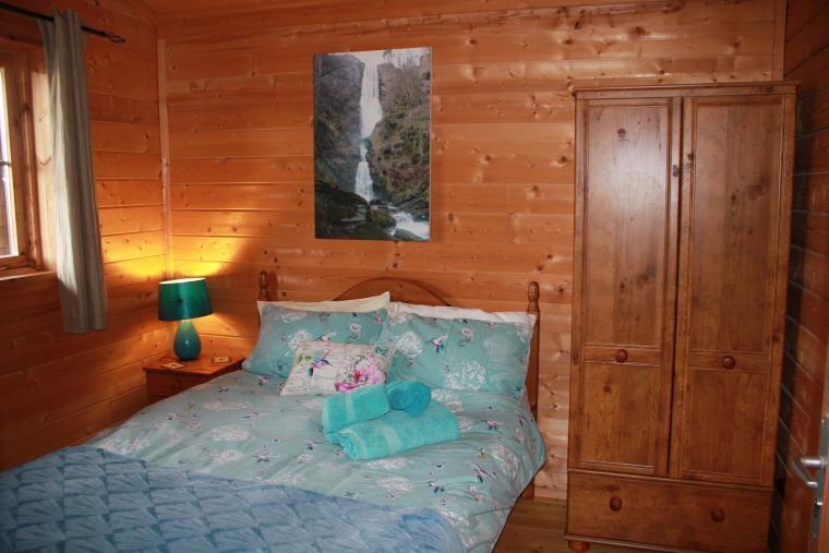 Double bedroom with walk in en suite shower room.