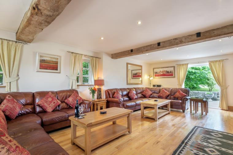 Stunning 27f Sitting Room with double doors opening onto the patio