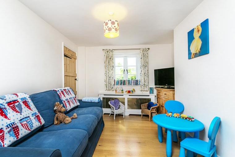 Play room just off the kitchen for our younger guests with toys, tv and DVD player