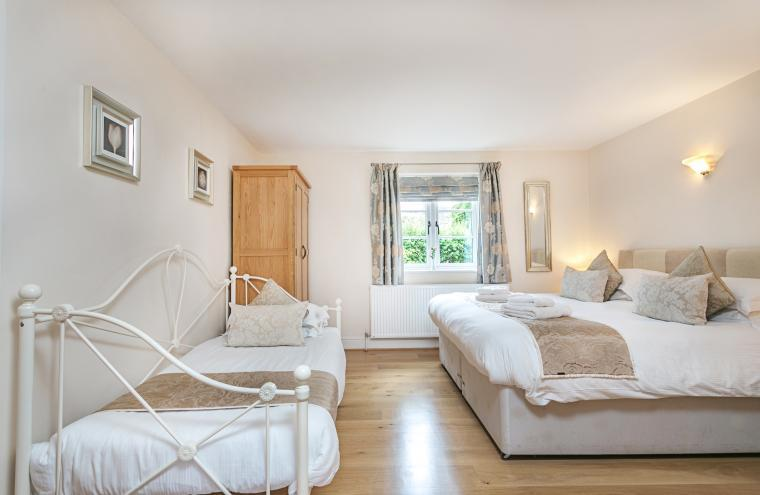 Downstairs bedroom has an full sized additional single bed suitable for children