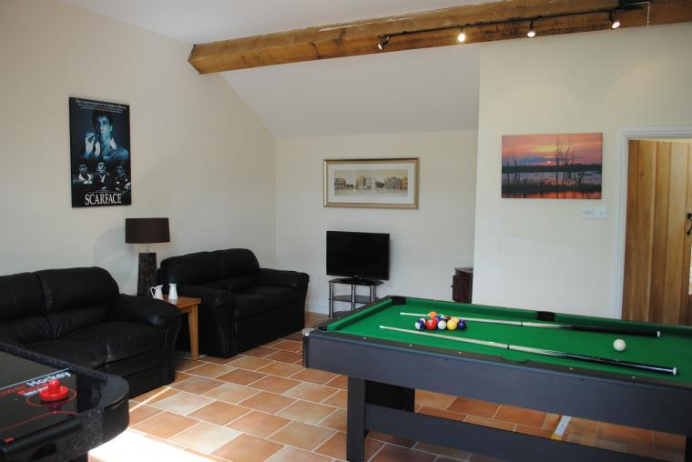 Games room with pool table, air hockey and table football