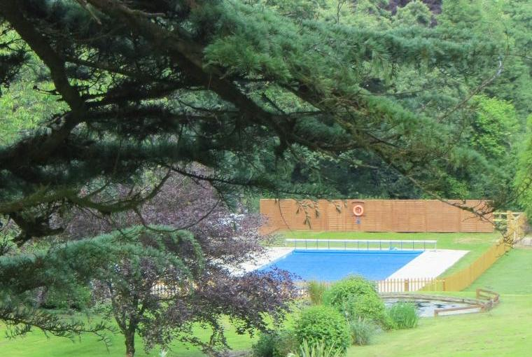 The heated outdoor pool and BBQ area