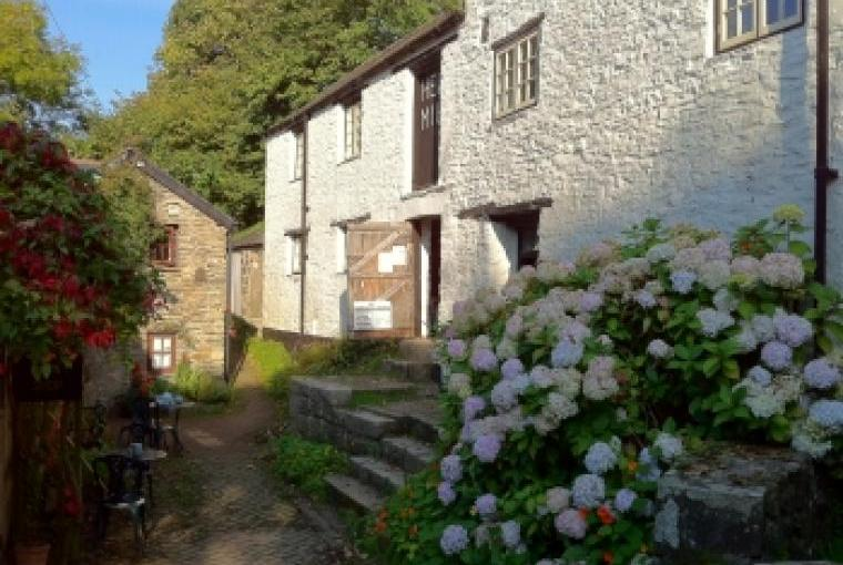 Hele Corn Mill on right, cottage on left